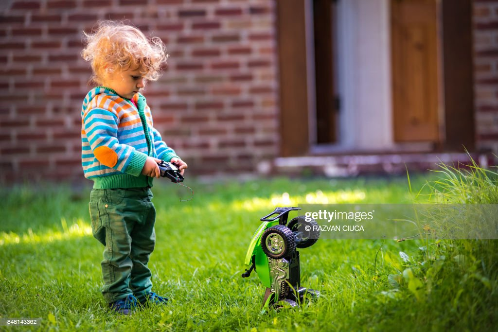 Toddler with toy car : Stock Photo