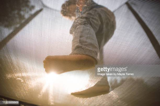 toddler's feet on a trampoline - autism awareness stock pictures, royalty-free photos & images