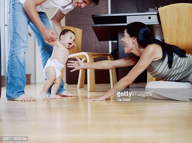 toddler's first steps - bent over babes stock pictures, royalty-free photos & images