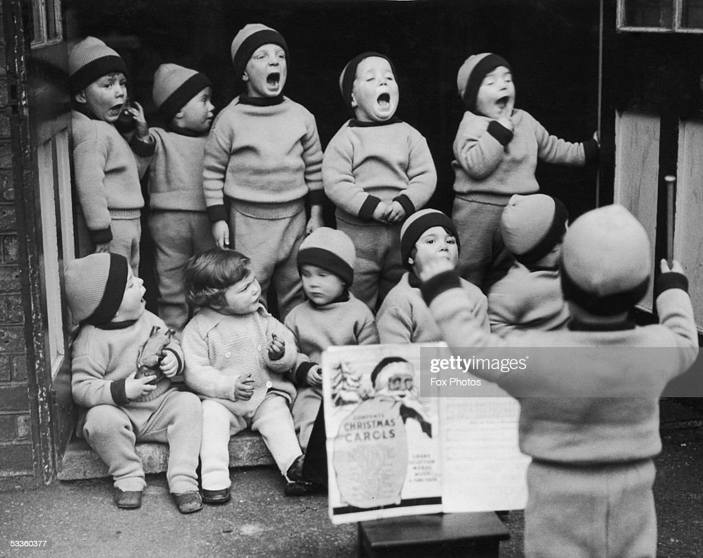 Toddlers from the Leytonstone branch of the Homeless Children's Aid Society rehearse a carol for their Christmas party, 1st December 1934.