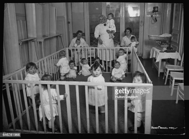 Toddlers in a playpen at a day nursery