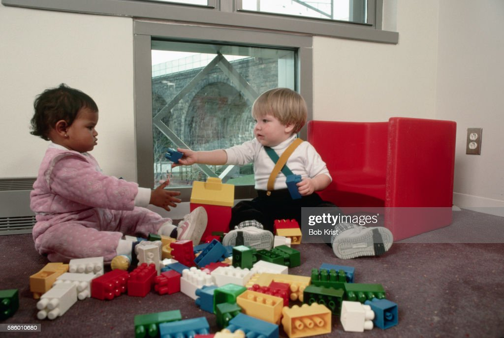 Toddlers Playing Together With Lego Blocks : Stock Photo
