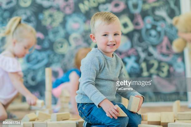 toddlers playing with blocks - preschool age stock photos and pictures