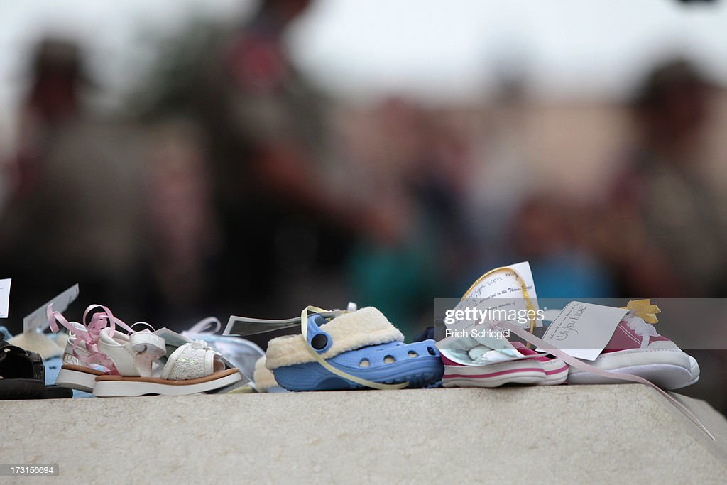 Toddlers shoes are symbolically placed at the Texas state capitol steps as pro-life supporters and pro-choice protesters rally at the Texas state capitol in favor and against the new controversial abortion legislation up for a vote in the state legislature on July 8, 2013 in Austin Texas. Texas Gov. Rick Perry called on a second legislative special session to pass an restrictive abortion law through the Texas legislature. The first attempt was defeated after opponents of the law were able to stall the vote until after first special session had ended.