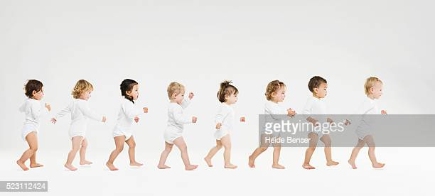 toddlers walking in a line - babies only stock pictures, royalty-free photos & images
