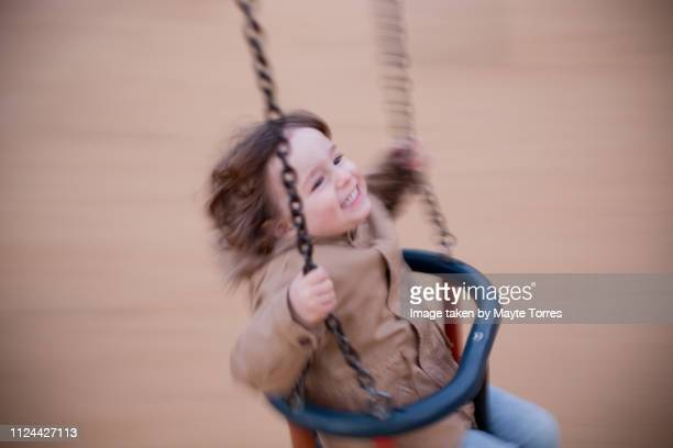 todler having a great time in the swing - autism awareness stock pictures, royalty-free photos & images