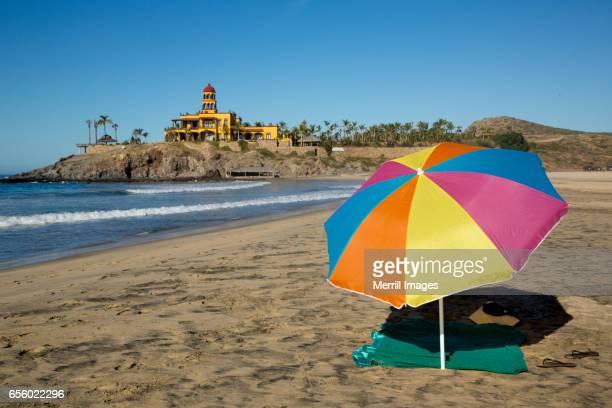 todos santos, umbrella on the beach. - todos santos mexico fotografías e imágenes de stock
