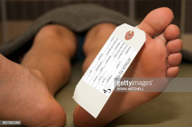 Toe tag tied to a corpse in a mortuary