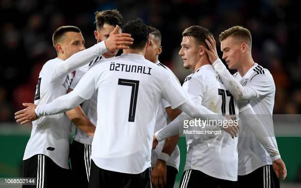 Toerles Knoell celebrates with team mates after scoring his teams third goal during the International Friendly match between Germany U21 and Holland...