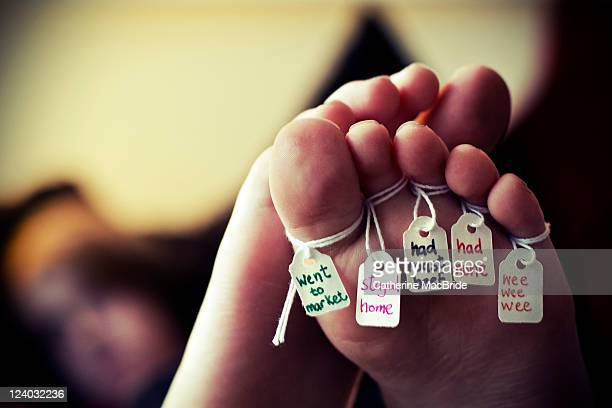 toes of foot labelled with words of nursery rhyme - catherine macbride stock pictures, royalty-free photos & images