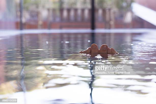 Toes sticking out of swimming pool, personal perspective