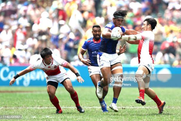 Tofatu Solia of Samoa makes a break against Japan on day two of the Cathay Pacific/HSBC Hong Kong Sevens at the Hong Kong Stadium on April 06 2019 in...