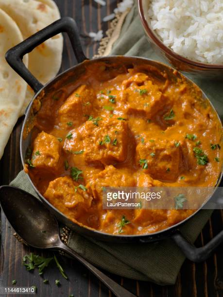 tofu curry with rice and naan bread - butter chicken stock photos and pictures