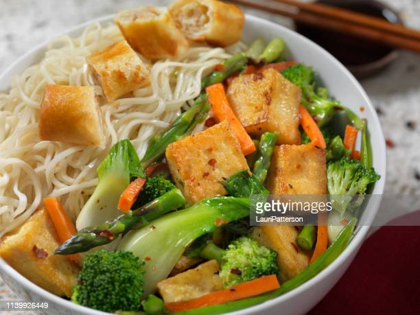 tofu noodle bowl with vegetable spring roll - soba stock pictures, royalty-free photos & images