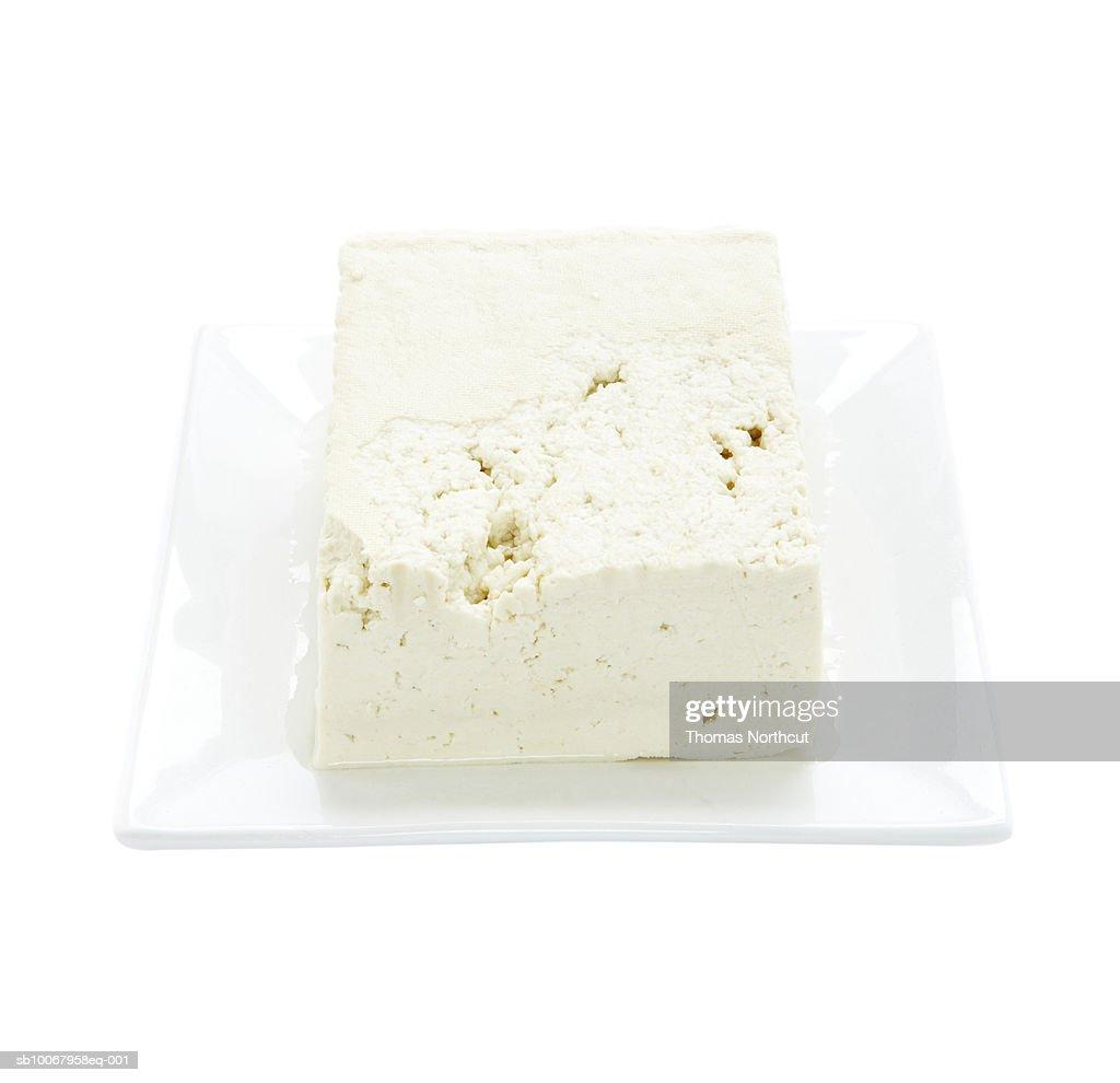 Tofu on plate on white background : Stock Photo