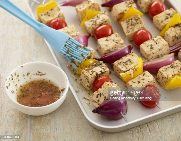 tofu skewers - step by step - basting brush stock photos and pictures