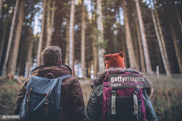 Together hiking in forest