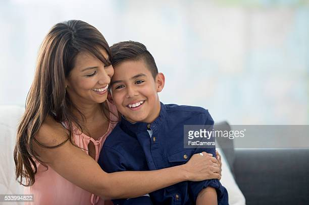together on mother's day - mother and son stock photos and pictures