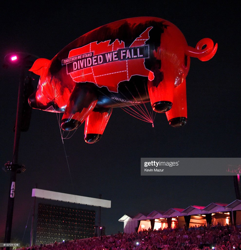 'Together We Stand, Divided We Fall' Pig floats over the audience during the Roger Waters performance at Desert Trip at The Empire Polo Club on October 9, 2016 in Indio, California.