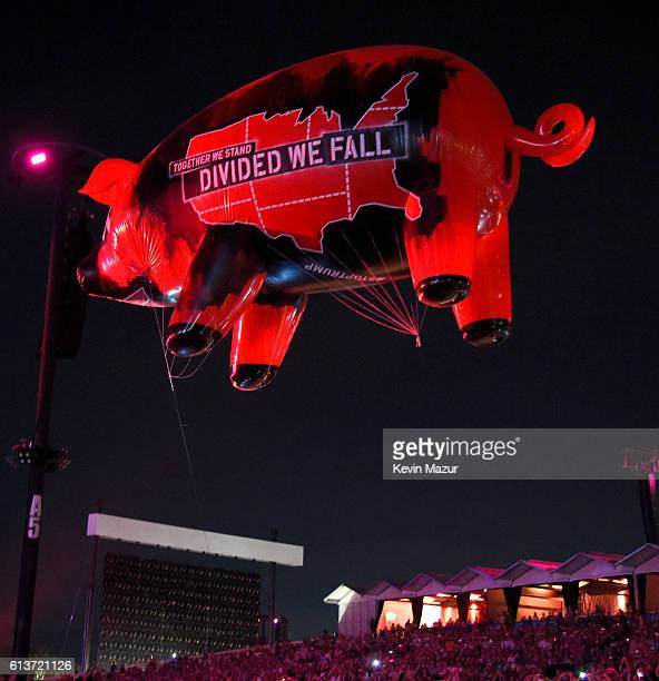 Together We Stand Divided We Fall Pig floats over the audience during the Roger Waters performance at Desert Trip at The Empire Polo Club on October...