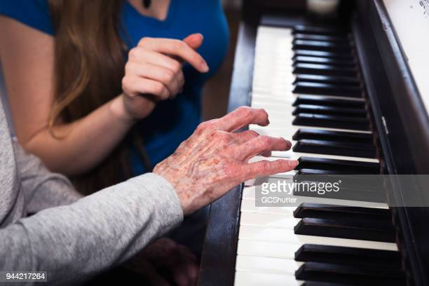 together with a the grandmother - keyboard player stock photos and pictures