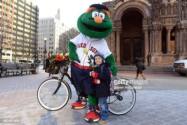 Together with KIND Healthy Snacks the Red Sox mascot Wally the Green Monster brightens a young Red Sox fans day by giving out flowers and KIND bars...
