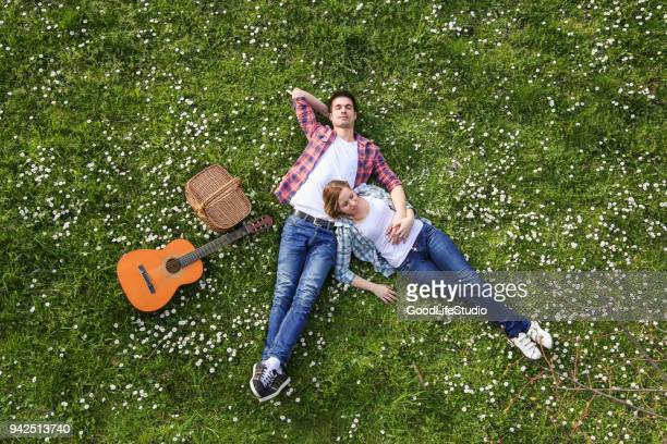 togetherness in happiness - lying down stock pictures, royalty-free photos & images