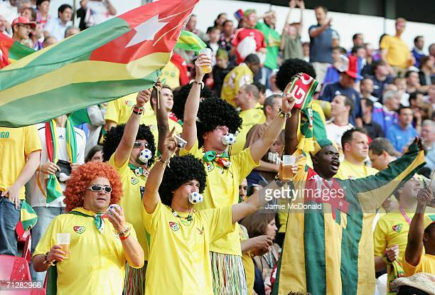 Togo fans show their colours prior to the FIFA World Cup Germany 2006 Group G match between Togo and France at the Stadium Cologne on June 23 2006 in...