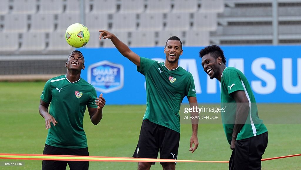 Togo forward Emmanuel Adebayor (R) jokes with teammates during training on January 20, 2013 at Moruleng stadium in Moruleng on the eve of a Group D 2013 Africa Cup of Nations match against Ivory Co...