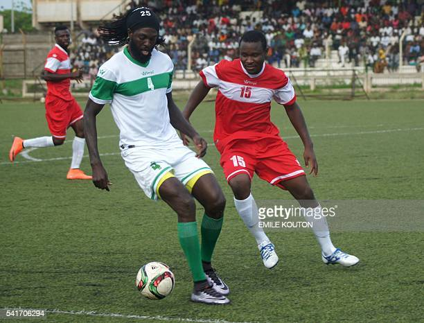 Togo national football team skipper Emmanuel Adebayor tries to controll the ball during an exhibition match to mourn former coach in Lome on June 19...