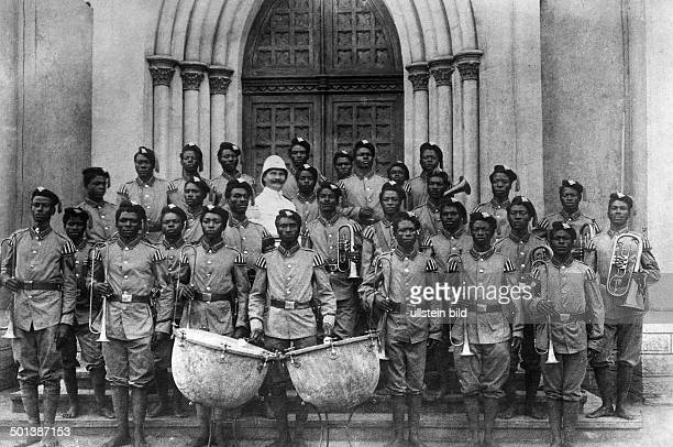 military band of the German protection force with their German band leader probably in the 1910s