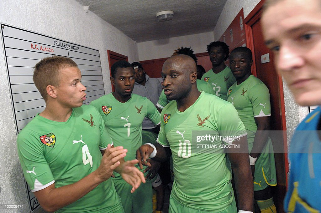 PERAUT - Togolese football national team players Guillaume Brenner (L), Malick Korodowou (2nd L) and Euloge Ahodikpe (C) wait in the corridor prior to the kick off of the friendly match against Gab...