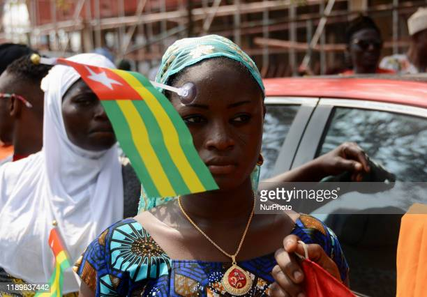 A Togolese girl clipped their national flag on her face during their protest in Lagos Nigeria on 19 December 2019 Togolese nationals gathered in...