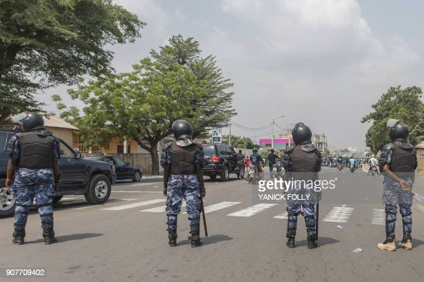 Togolese police watch a protest rally by women marching against Togo's president in the capital Lome on January 20 2018 A coalition of 14 political...