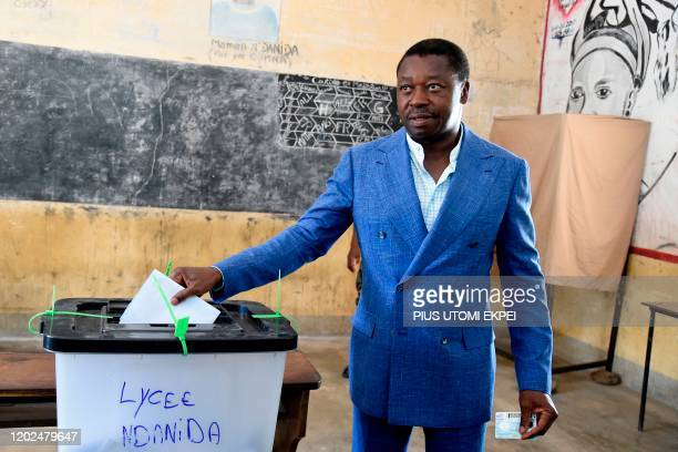 Togolese President and candidate of the ruling Union for the Republic party Faure Gnassingbe casts his vote at a polling station in Kara, on February...