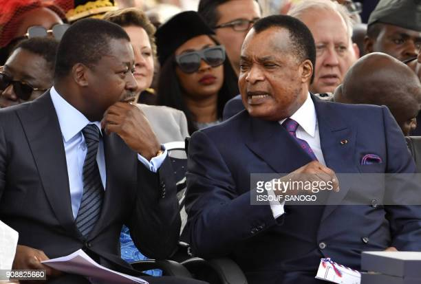 Togolese President Faure Gnassingbe listens to Congo's President Denis Sassou Nguesso during the swearingin ceremony of Liberia's presidentelect on...