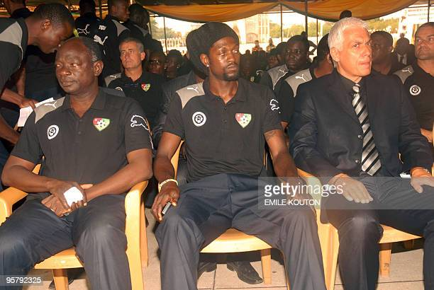 Togolese striker Emmanuel Adebayor sits on January 15 2010 in Lome with unidentified members of the team as they attend a national homage ceremony...