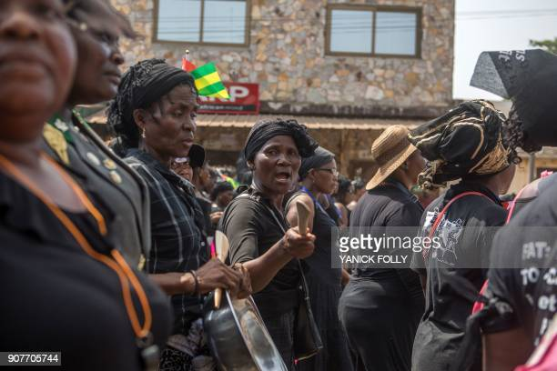 Togolese woman dressed in black takes to the streets of the capital Lome during a protest rally against Togo's president on January 20 2018 A...