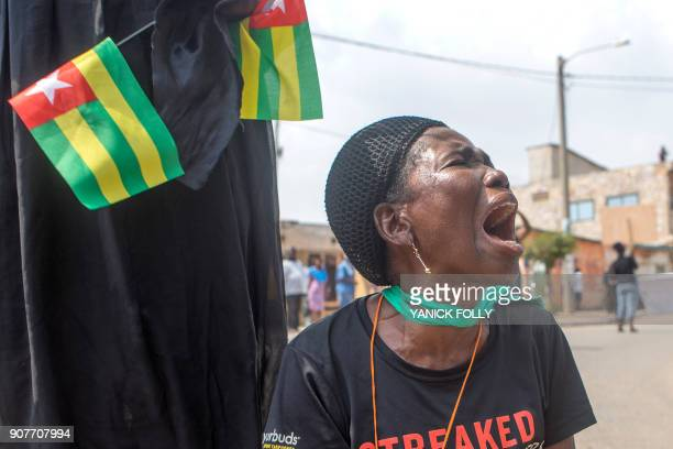 A Togolese woman reacts during a protest rally by women in the capital Lome against Togo's president on January 20 2018 A coalition of 14 political...