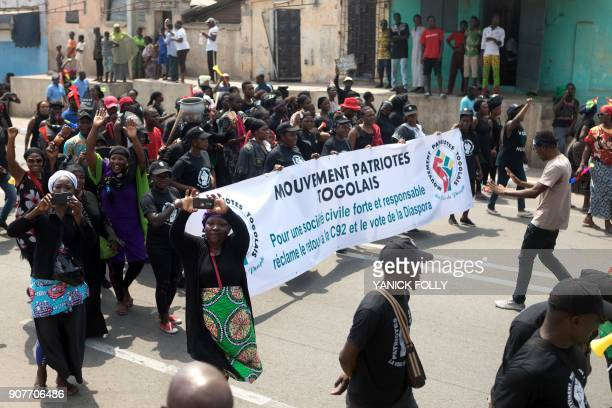 Togolese women dressed in black take to the streets of the capital Lome during a protest rally against Togo's president on January 20 2018 A...