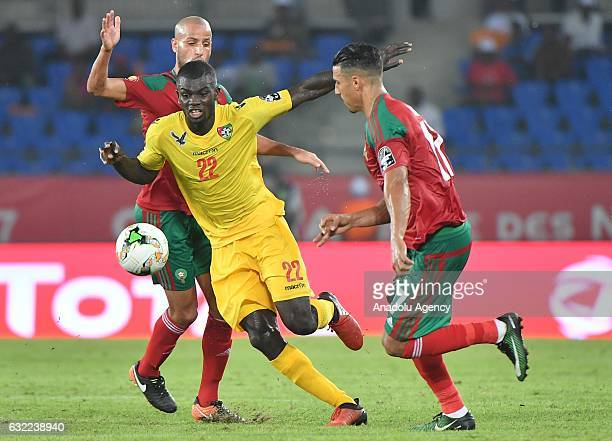 Togo's Bebou vies for the ball against Morocco's Dirar during the African Cup of Nations Group C soccer match between Morocco and Togo at the Stade...