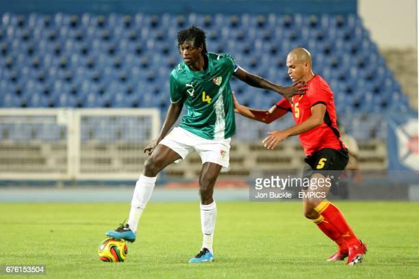 Togo's Emmanuel Adebayor and Angola's Kali battle for the ball