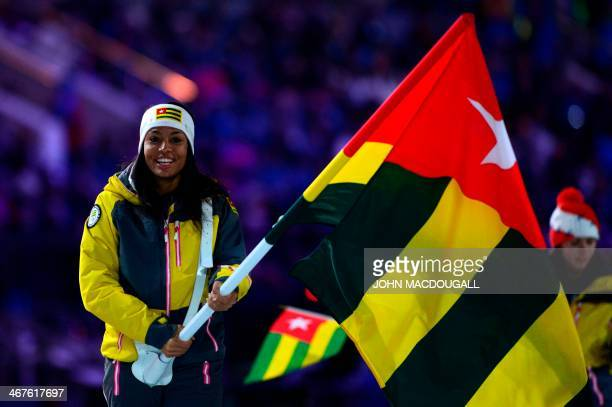 Togo's flag bearer crosscountry skier Mathilde Petitjean leads her national delegation during the Opening Ceremony of the Sochi Winter Olympics at...