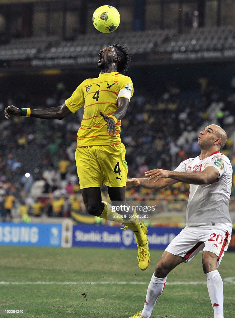 Togo's forward Emmanuel Adebayor (L) vies with Tunisia's defender Aymen Abdennour (R) during the Africa Cup of Nations 2013 group D football match Togo vs Tunisia on January 30, 2013 at the Mbombela stadium in Nelspruit. Togo drew 1-1 with Tunisia today to complete the Africa Cup of Nations quarter-final cast list and send the Carthage Eagles heading back to Tunis.