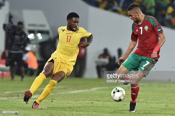 Togo's forward Serge Gakpe challenges Morocco's forward Youssef EnNesyri during the 2017 Africa Cup of Nations group C football match between Morocco...