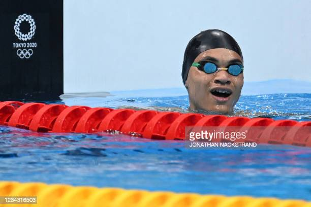 Togo's Mawupemon Otogbe reacts after winning a heat for the men's 50m freestyle swimming event during the Tokyo 2020 Olympic Games at the Tokyo...