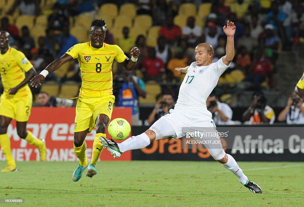 Togo's midfielder Komlan Amewou (R) vies with Algeria Midfielder Adlene Guedioura during the 2013 African Cup of Nations football match Algeria vs Togo at Royal Bafokeng stadium in Rustenburg on January 26, 2013.