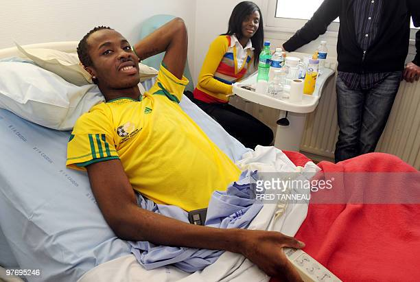 Togo's national football team goalkeeper Kodjovi Obilale injured in a rebel attack before the Africa Cup of Nations in Angola rests with friends at...