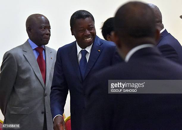 Togo's President Faure Gnassingbe leaves the conference room after a meeting with Ghanian President and ECOWAS chairmen John Dramani Mahama and Ivory...