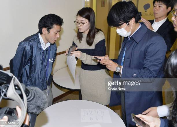 A Toho Air Service Co official is questioned by reporters in Tokyo on Nov 8 after its helicopter crashed in the Gunma Prefecture village of Ueno...